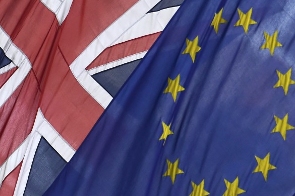 The British Union flag and European Union flag are seen hanging outside Europe House in central London